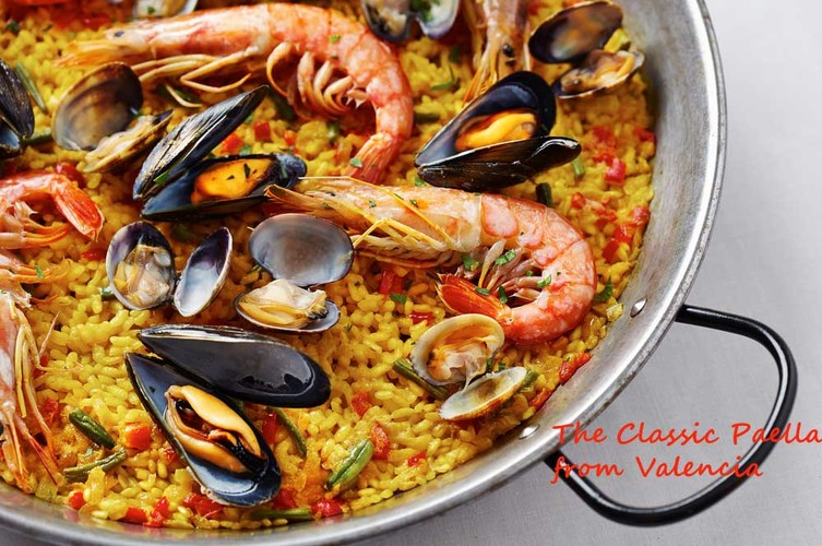 travelibro Spain Barcelona Logrono Madrid San sebastian Seville Valencia Culinary Journey To Spain Cropped-Valencia-Paella.jpg